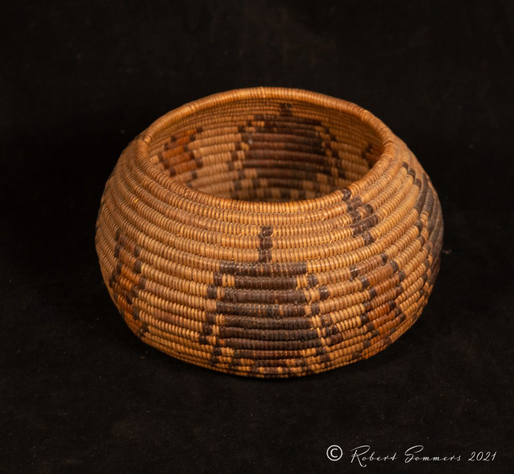 Mission Indian basket with spiders